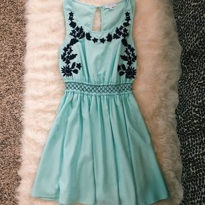 Embellished teal dress